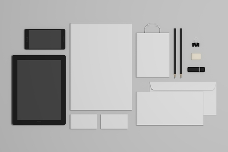 Mockup business branding template on gray background. Set of stationery with a black tablet and a mobile phone. 3d illustration.