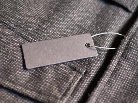 Label price tag mockup on brown coat.