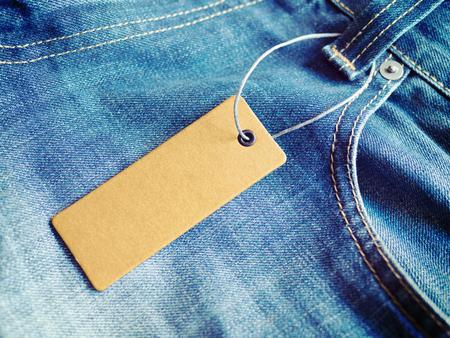 Label price tag mockup on blue jeans.