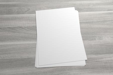 Blank 3D illustration stack of flyer or leaflet on wooden background Standard-Bild