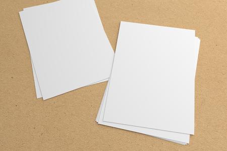 Blank couple of stacks 3D illustration flyers mockup on texture