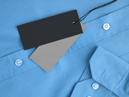 Two label price tags mock-up on blue shirt. Standard-Bild