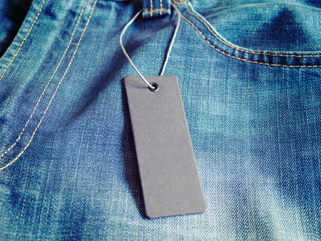 Blank mock-up label tag on clothes.