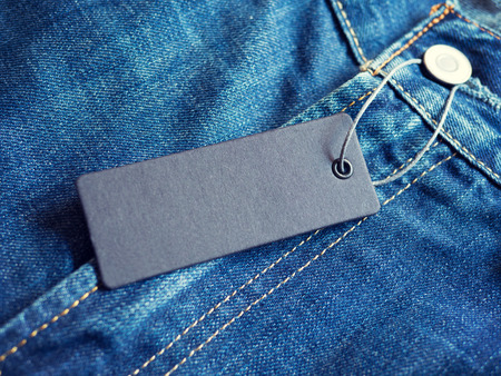 Blue jeans detail with blank label tag Standard-Bild