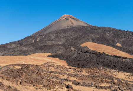 Pico del Teide, deserts in the dry mountains. Blue sky. Rocky and vulcanic surface.