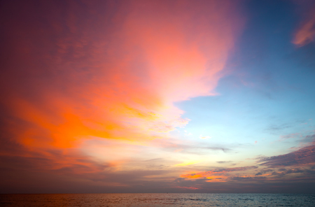 golden dusk: Burning clouds and tropical sea after the sun is set