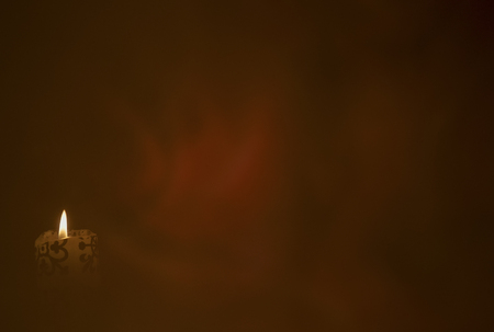 Abstract background. Candle and red reflections on a dark background Stockfoto