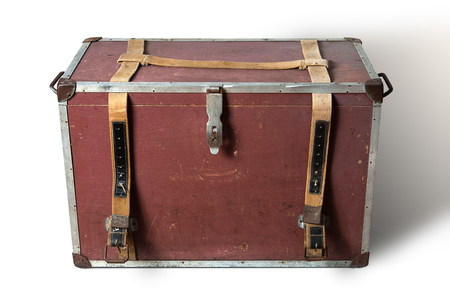 Old traveling box with straps isolated on white background