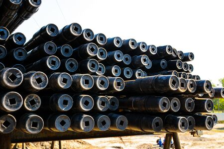 Stack of new drill pipe on racks