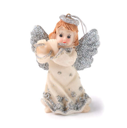 Figurine of a Christmas angel on a white background. Isolated object, place for text.