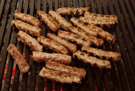 cevapcici - a sort of rolled minced beef, pork and lamb meat preparing on grill similar to Turkish kebab. photo