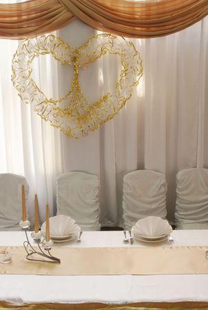 Wedding table reception decoration - focus on heart photo