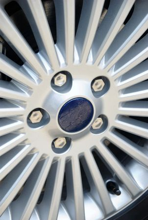 Closeup detail of Aluminum car wheel with five screws photo
