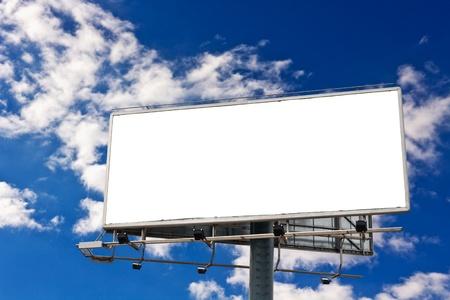 Empty billboard in front of beautiful cloudy sky
