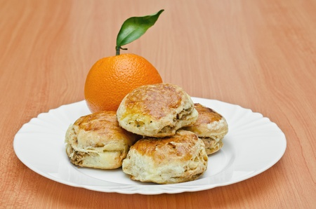 crackles: Pork Rind biscuits and orange on the plate, Shallow DOF Stock Photo