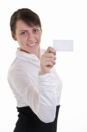Businesswoman showing and handing a blank business card  Business woman in white shirt, high key, focus on card Stock Photo - 12899524