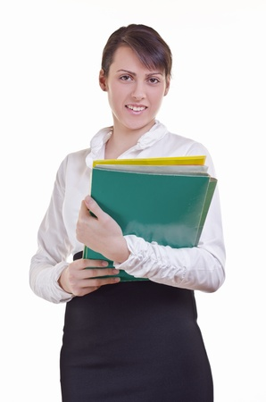 Portrait of a happy business woman holding a pile of  file folder  photo