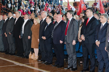 hymn: Zrenjanin, Serbia - April 26 2012 - Convention of coalition SPS PUPS JS - Leaders of political parties standing during Serbian hymn Editorial