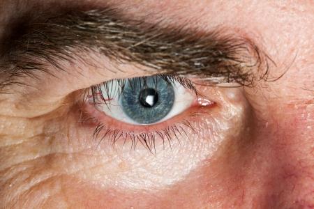 Blue Eye of mature man, close-up horizontal shot Stock Photo - 13640431