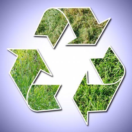 conceptual recycling sign with grass, vignetted background photo
