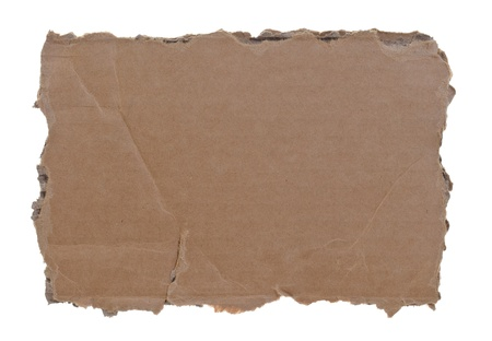 high resolution photograph of torn cardboard piece isolated over white background photo