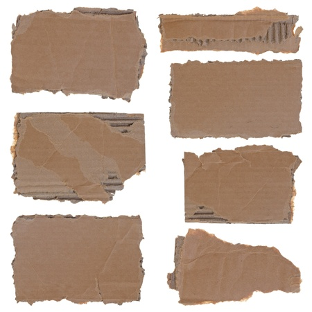 Collection of seven torn carboard pieces isolated over white background photo