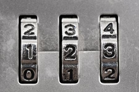secure money: Macro of combination lock - dials set to 123,  Shallow DOF Stock Photo