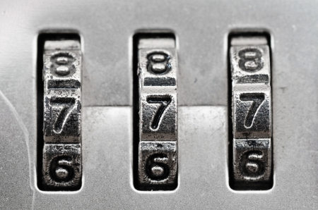 Macro of combination lock - dials set to 777, Shallow DOF photo