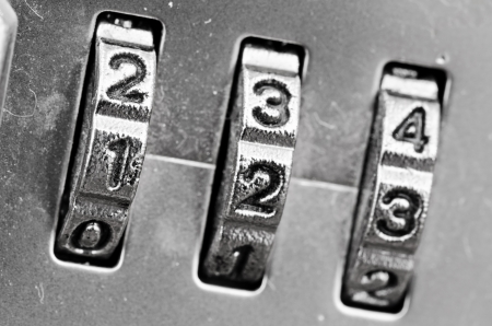 secure money: Macro of combination lock - dials set to 123,  Selective focus on first dial Stock Photo