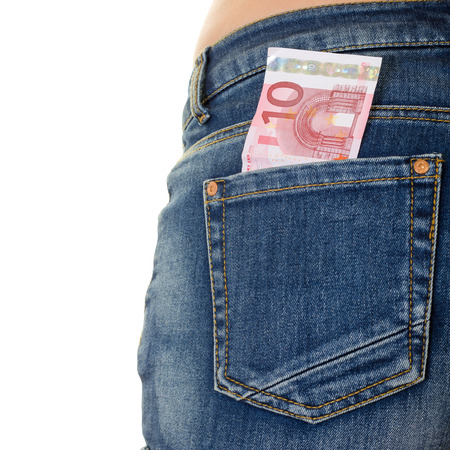 Image of money in an denim back pocket over white photo