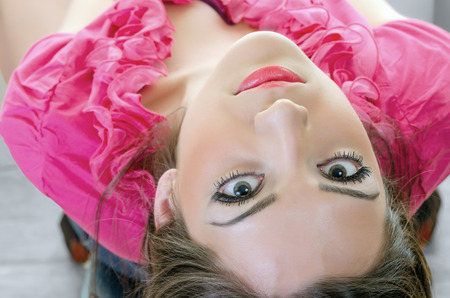 lustful: Closeup of Young brunette with green eyes looking backwards, horizontal shot from upper angle