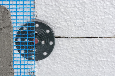 dowel: Polystyrene insulation boards fixed with dowel and mesh covered with mortar