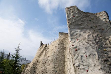 Outdoor artificial climbing wall in a public park