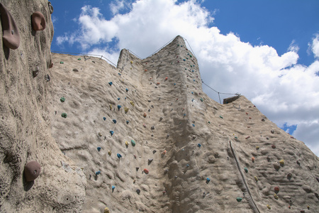 Outdoor artificial climbing wall on a nice day Stock Photo - 80245722