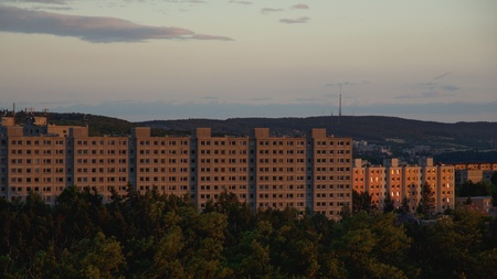 Old prefabricated housing estates in the outskirts of a town at sunset