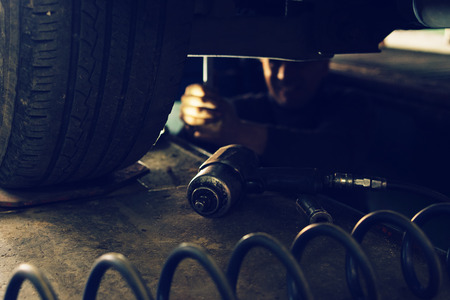 Repairing car wheels at the workshop garage low angle view Banque d'images - 119391522