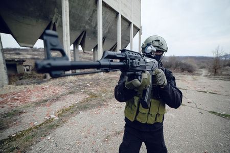 Special forces police soldier armed with machine gun aiming ready to attack