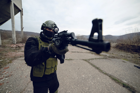 Armed terrorist aiming machine gun rifle Archivio Fotografico