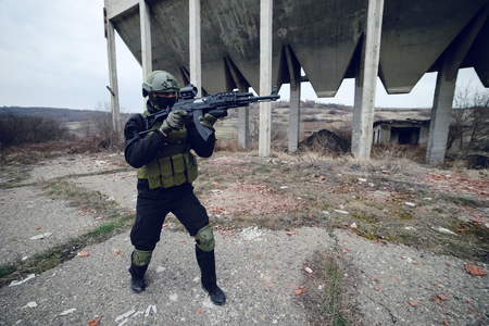 Special forces police soldier armed with machine gun aiming ready to attack special operation anti terrorist Stock Photo