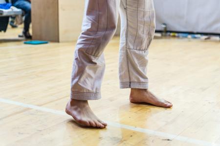 Close up on Brazilian Jiu Jitsu BJJ Judo fighter feet at the tournament waiting for the fight