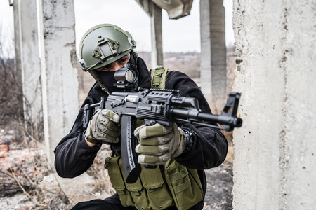 Anti terrorist SWAT special police in action aiming automatic rifle on the rescue mission