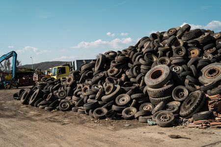 Pile of old used tires car wheels recycle industry