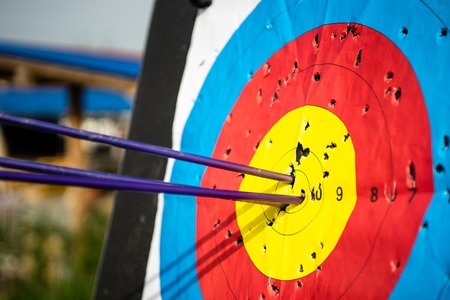 Close up on three arrows in the middle center of the target goal achieved success archery Stok Fotoğraf