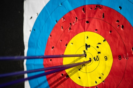 Close up on three arrows in the middle center of the target goal achieved success archery Reklamní fotografie