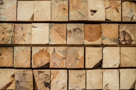 Close up on stack of rough sawn timber pine lumber construction material at the building site