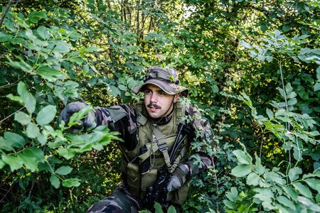 Army soldiers special forces in the wood forest patrol airsoft game war battle mission campaign