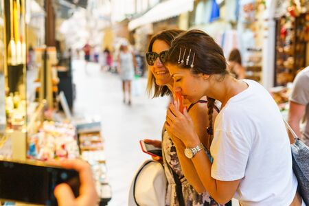 Two women smelling the homemade soap local product on summer vacation holiday
