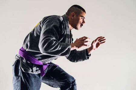 Brazilian Jiu JItsu BJJ Fighter in A Fighting Stance Stock Photo