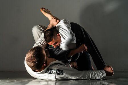 Brasilianisches Jiu Jitsu BJJ Training Sparring Fight Triangle Submission