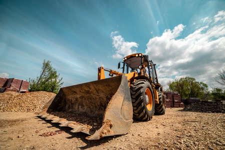 Front view on bulldozer excavator work machine in sunny summer day Stock Photo